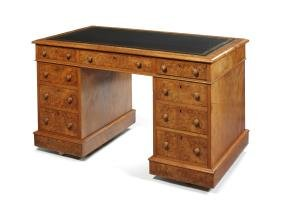 A Victorian burr walnut pedestal desk by T.H. Filmer