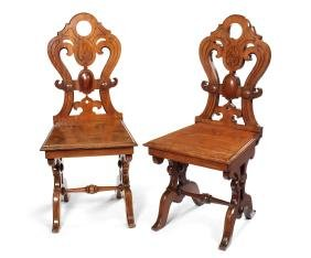 A pair Victorian mahogany Elizabethan style hall chairs