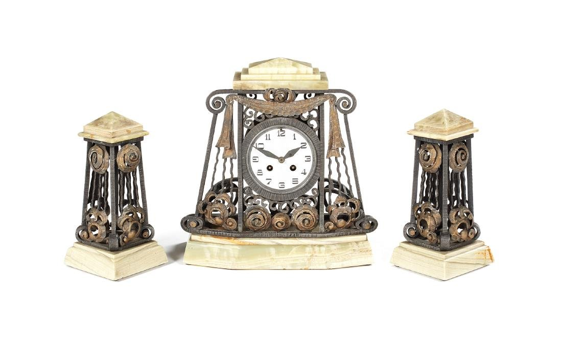 An Art Deco onyx wrought iron & gilded clock garniture
