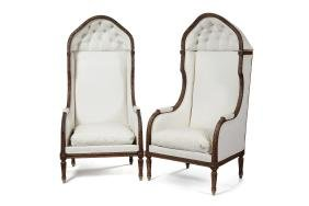 A pair of early 20th c. carved walnut porters chairs
