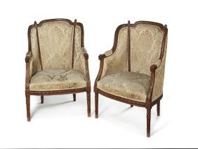 A pair of late 19th c. French carved walnut bergeres