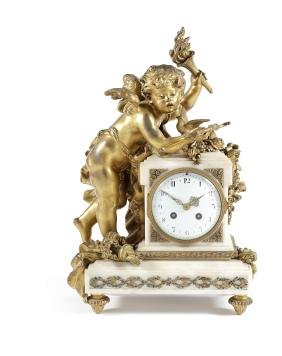 A late 19thc. French gilt bronze and white marble clock