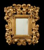 A small Italian carved giltwood mirror