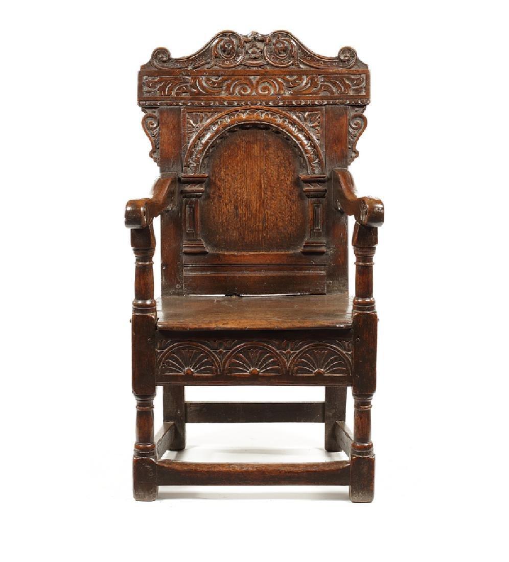 A Charles II oak armchair