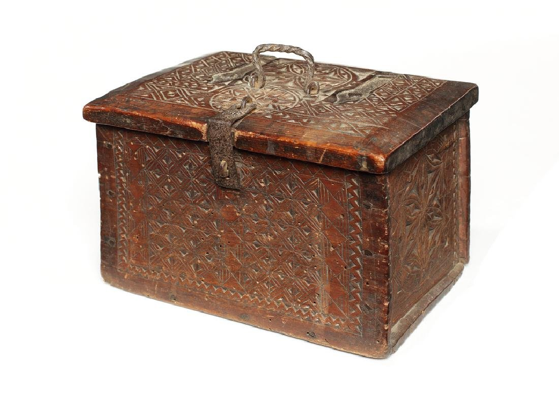 A small N. European chip-carved pine box, mid 18thc