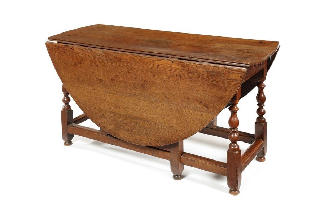 A large Charles II oak gate-leg table
