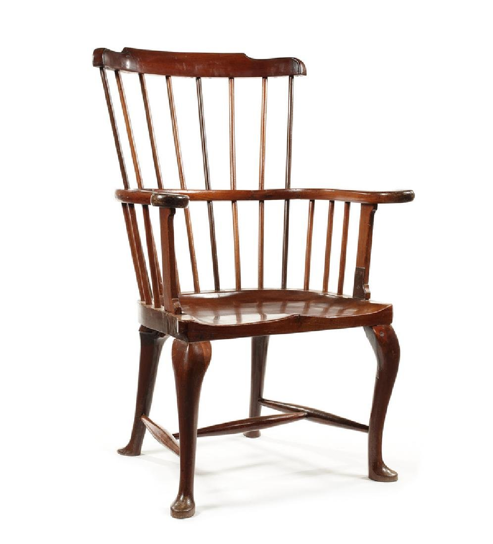 A George III mahogany comb-back Windsor armchair