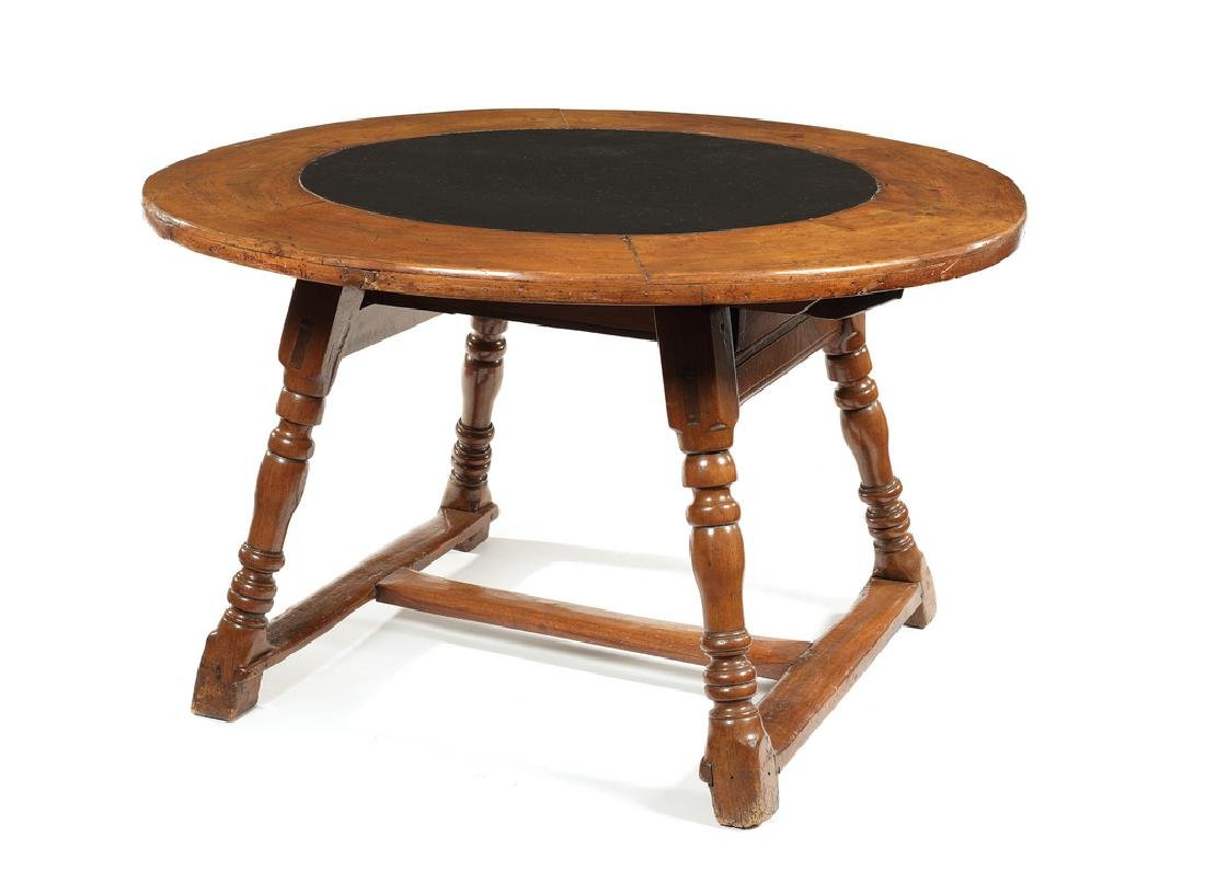 A Swiss walnut and slate-inset circular table, 18thc