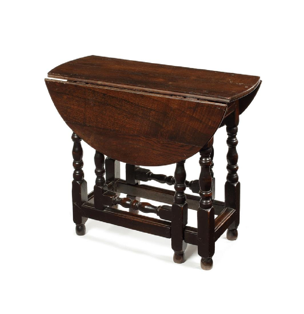 A small William and Mary oak gate-leg table