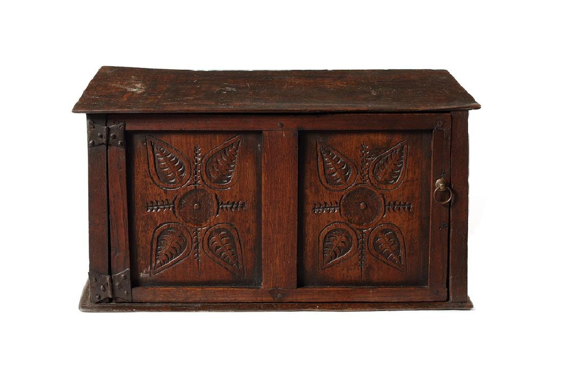A small oak spice cabinet, English, early 18th century