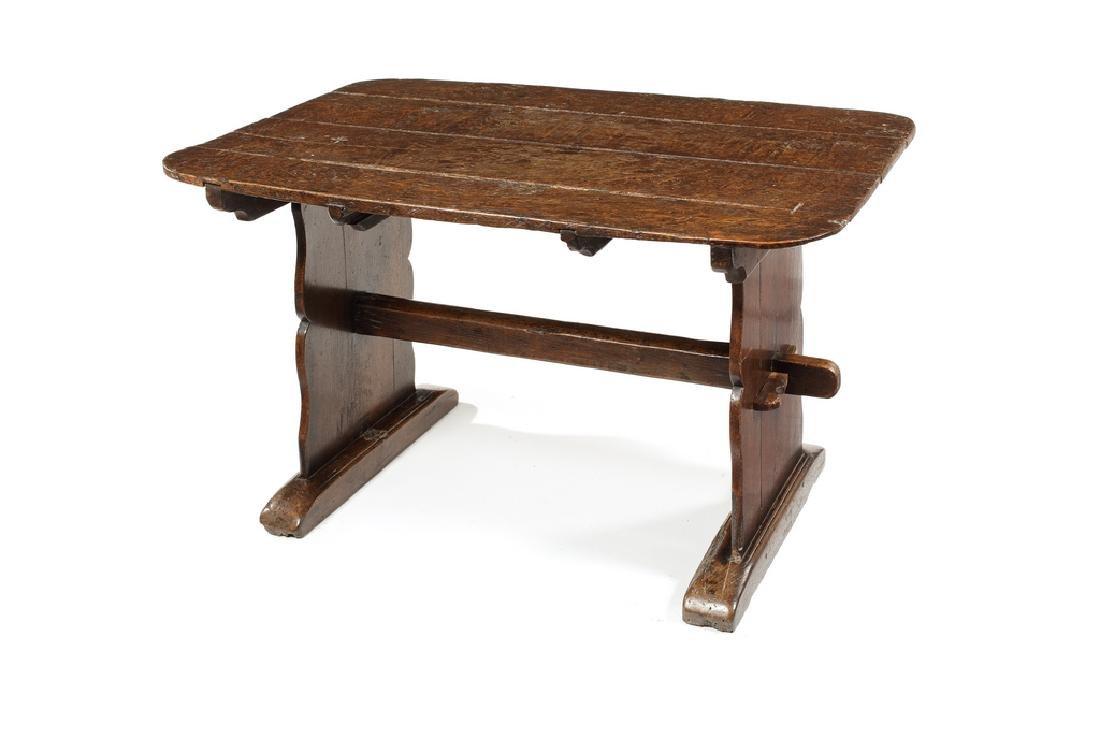 An oak plank-top trestle table
