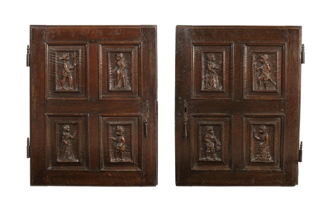 Two pairs of French oak panelled cupboard doors, 17thc