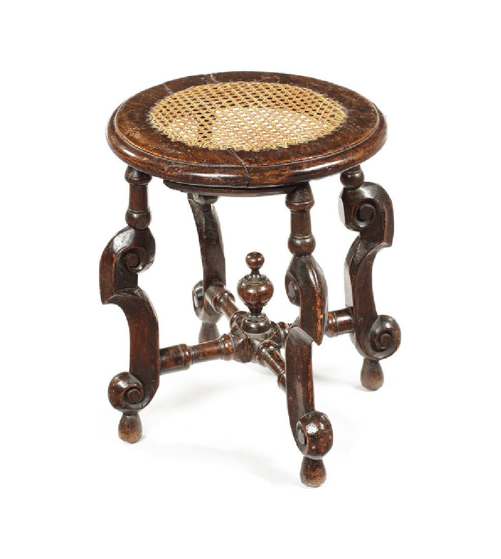 A William and Mary carved beechwood and walnut stool