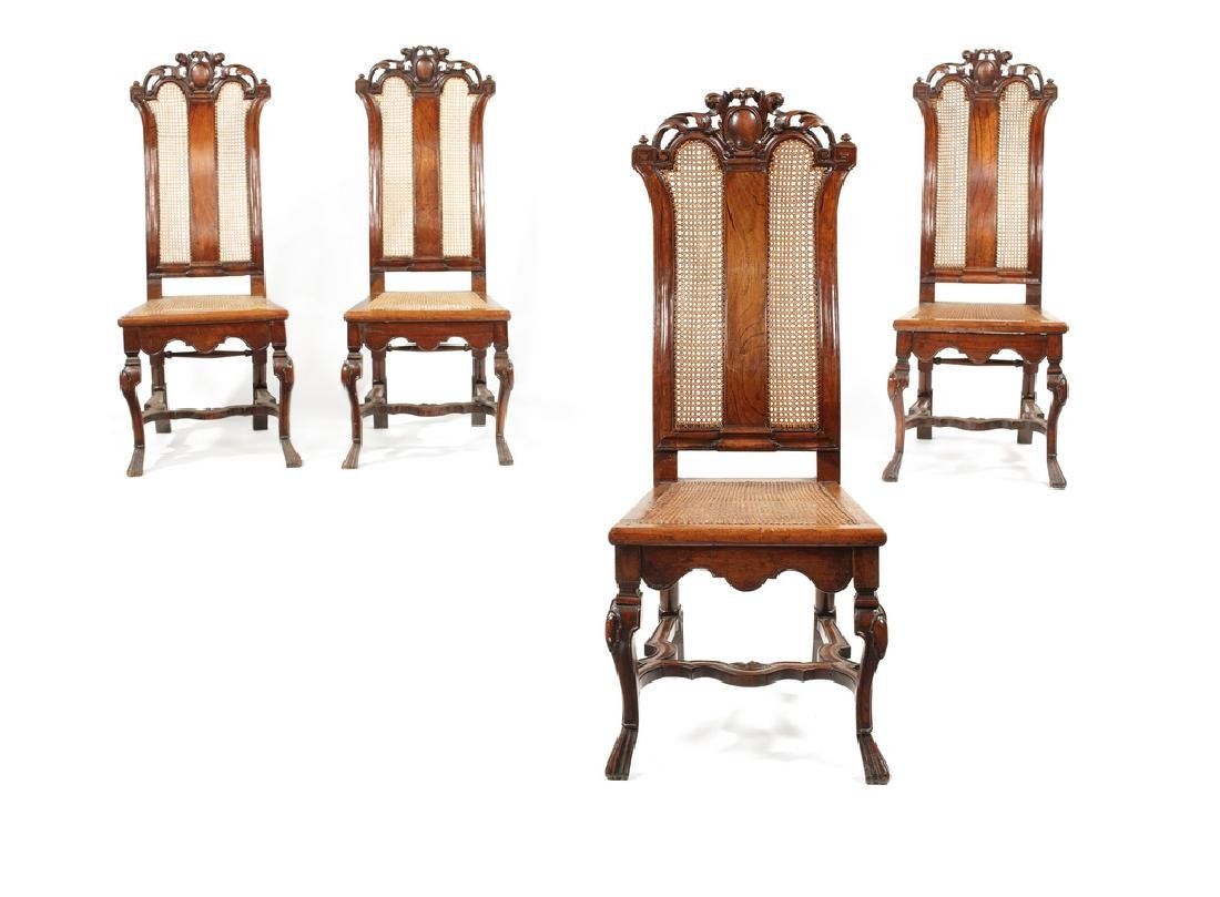 A set of four William and Mary walnut cane side chairs