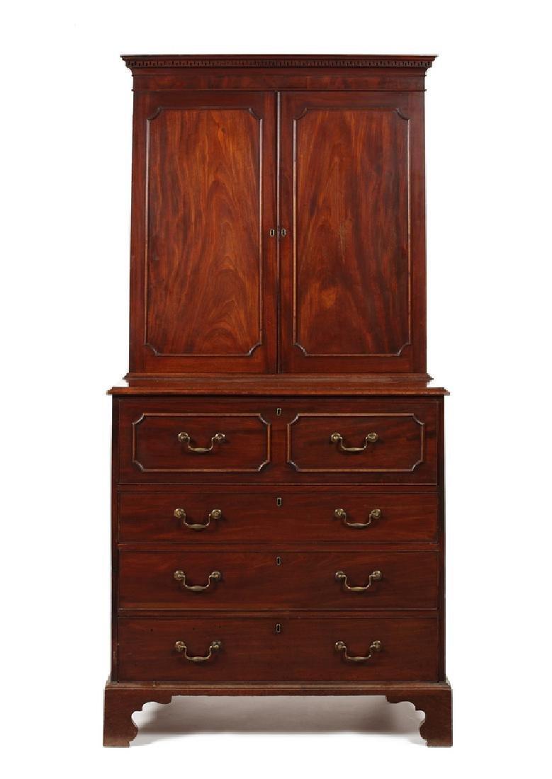 A George III mahogany secretaire cabinet