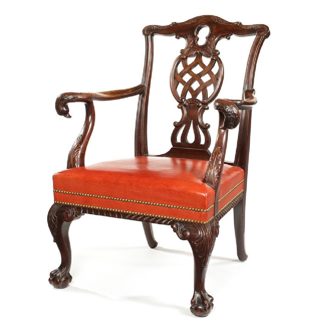 A George III style carved mahogany open armchair