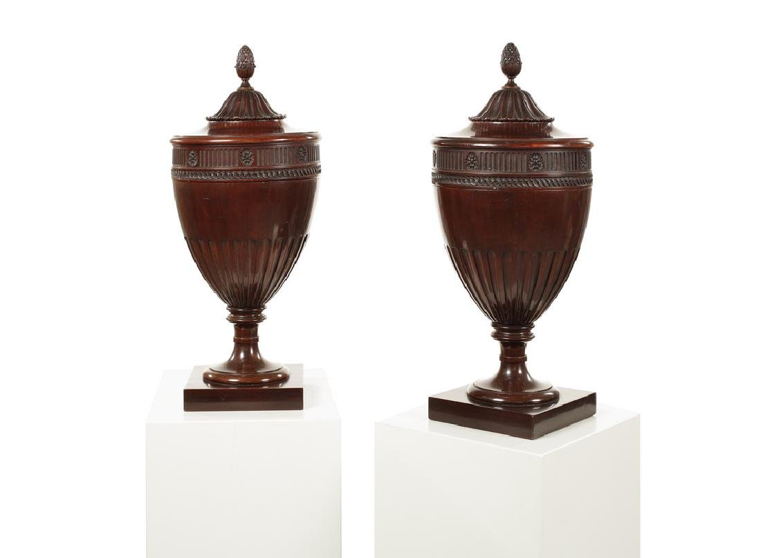 A pair of 19th century carved mahogany knife urns