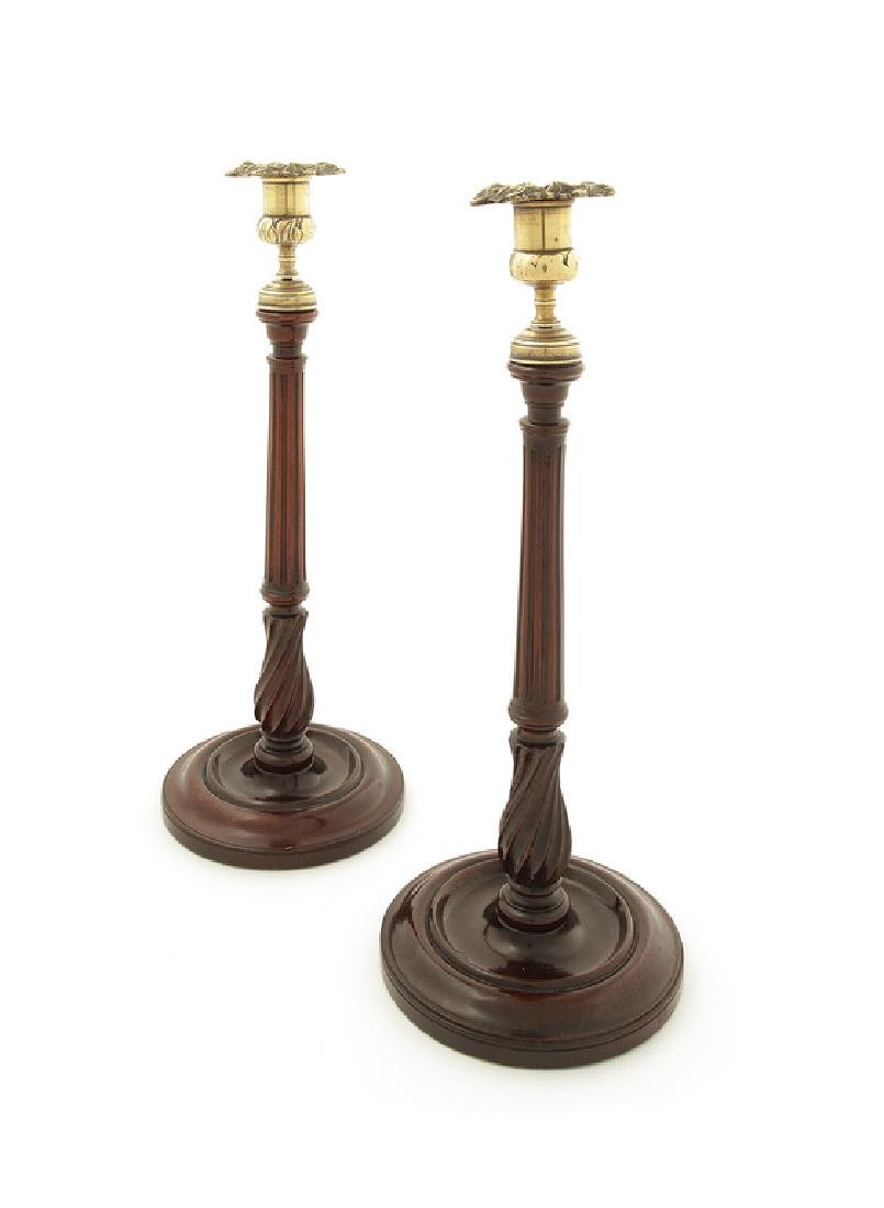 A pair George III mahogany and gilt brass candlesticks