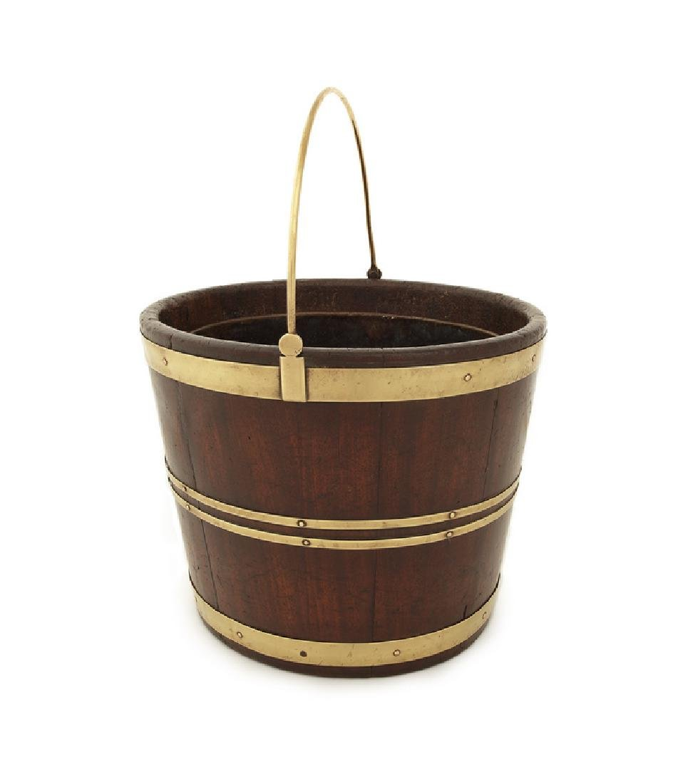 A George III mahogany and brass bound oval bucket