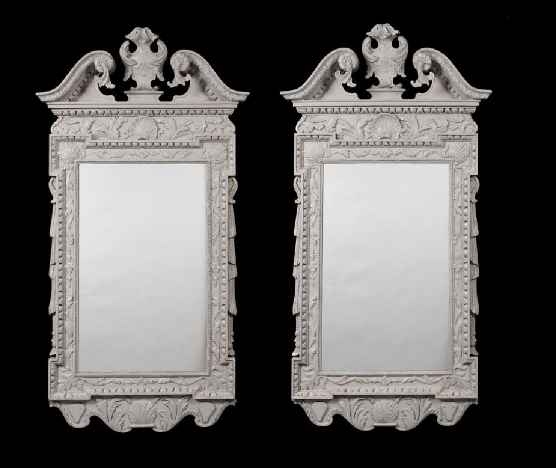 A pair of George II style grey painted mirrors