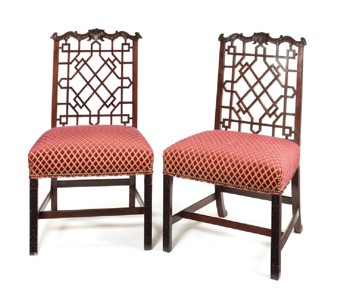 A pair of Chinese Chippendale style dining chairs