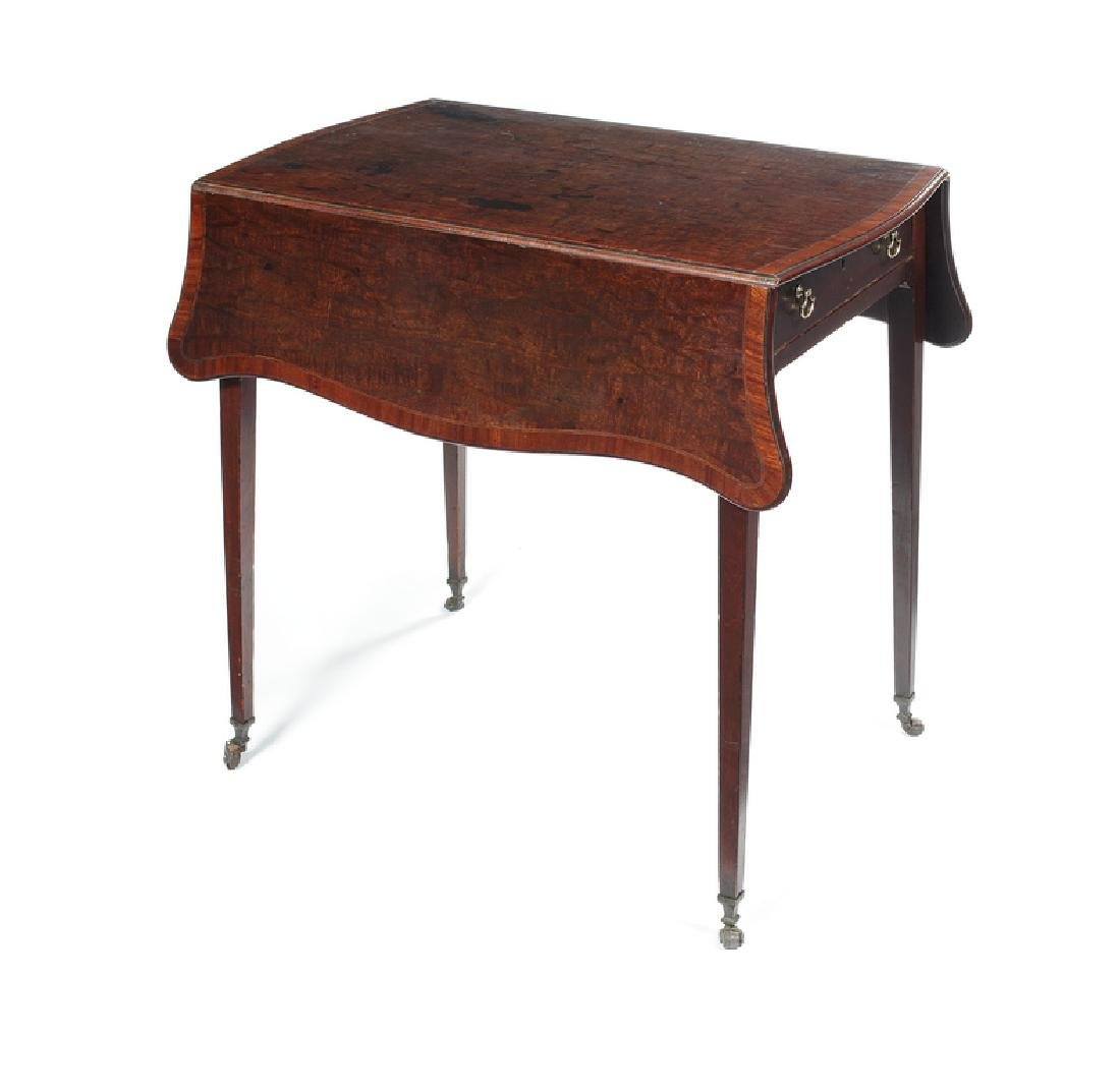 A George III figured mahogany serpentine Pembroke table