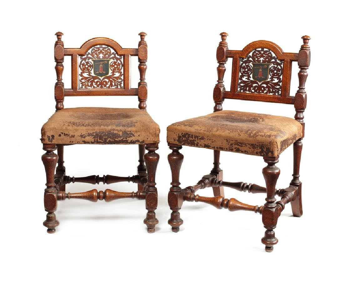 A pair of William IV oak hall chairs