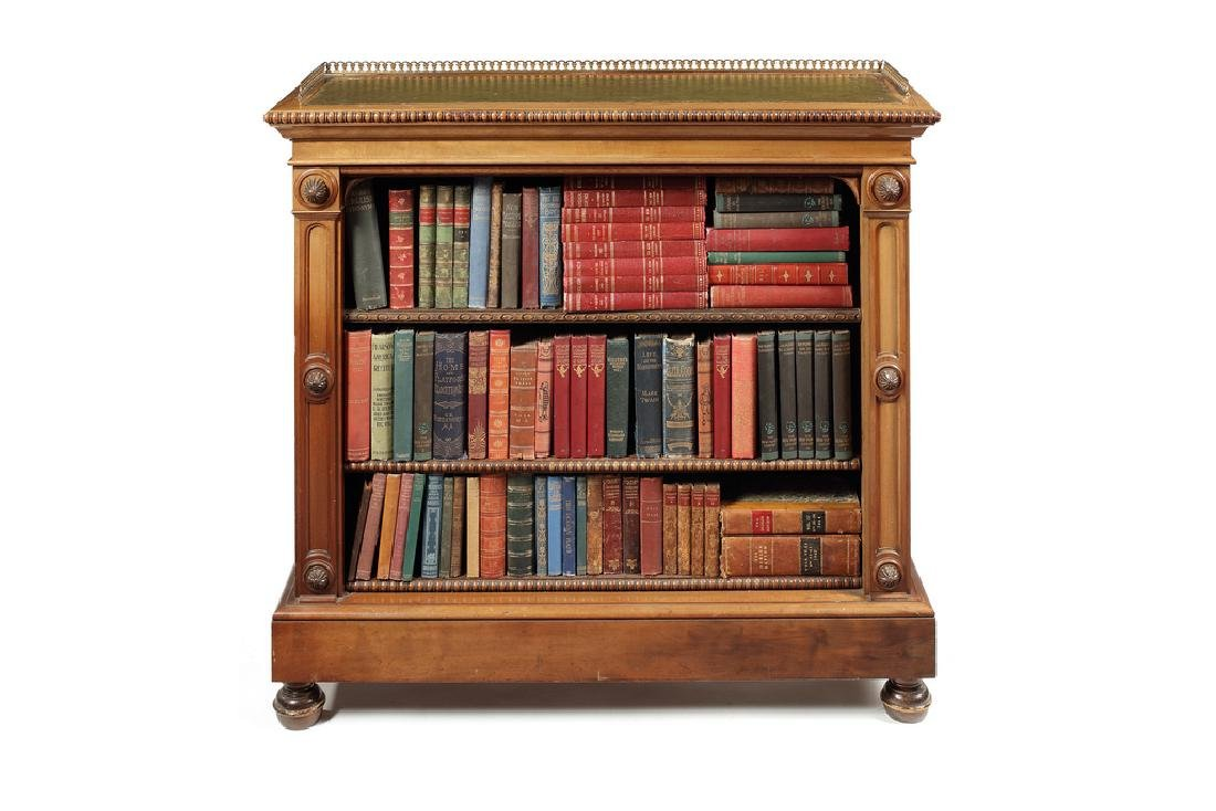 A Victorian satinwood and mahogany carved open bookcase