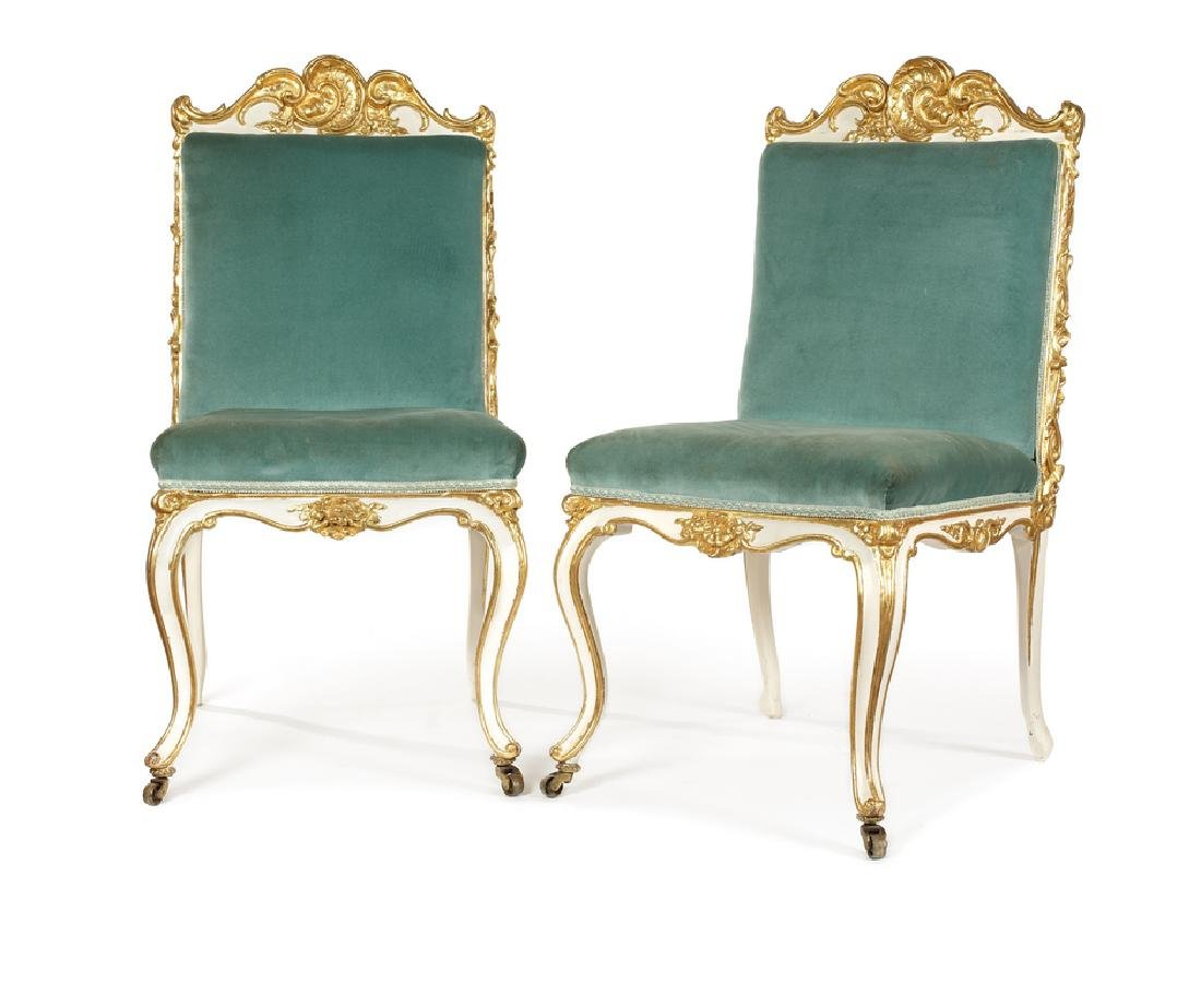 A pair of William IV cream and parcel gilt side chairs