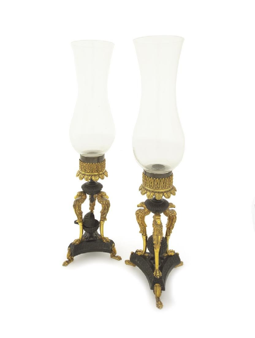Pair of Empire style bronze and gilt bronze storm lamps