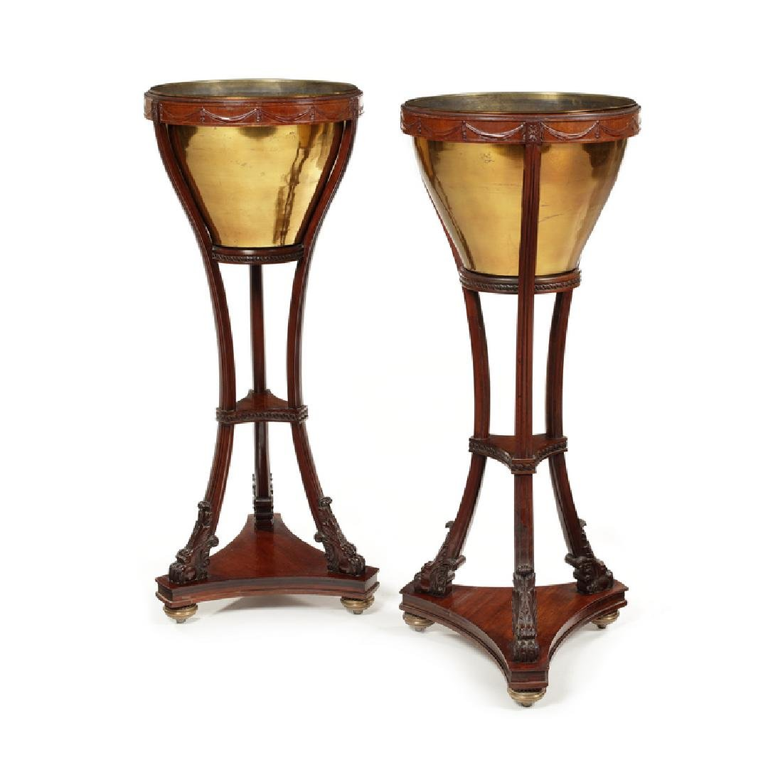 A pair of late 19th century carved mahogany jardinieres