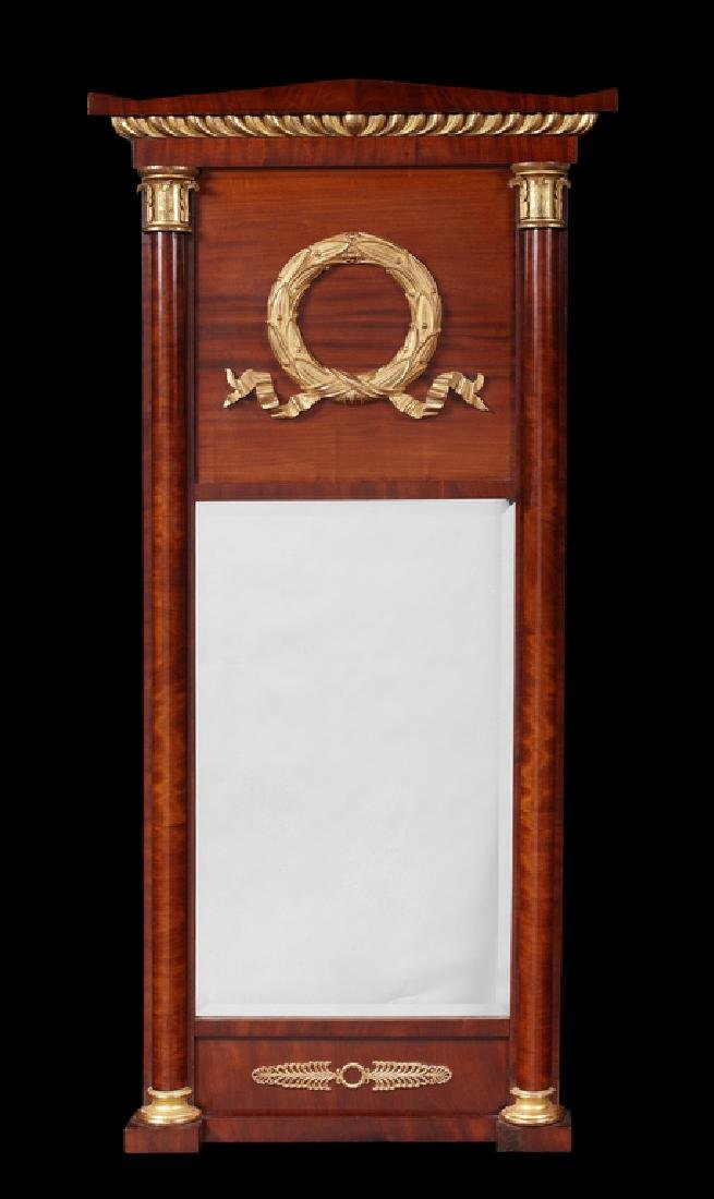 An Empire mahogany, parcel gilt mounted mirror