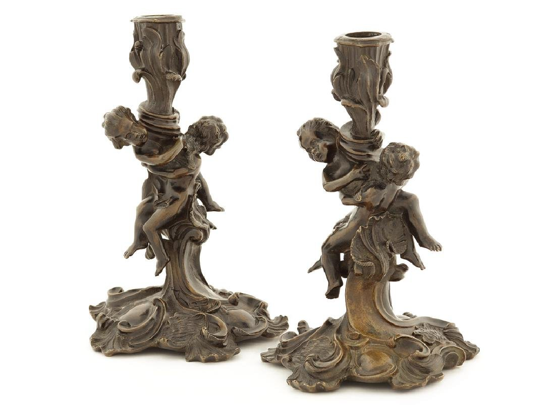 Pair of late 19th century patinated bronze candlesticks