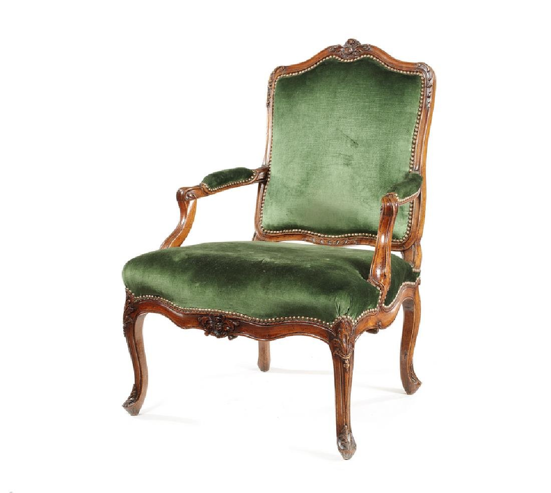 A Louis XV carved walnut fauteuil à la reine