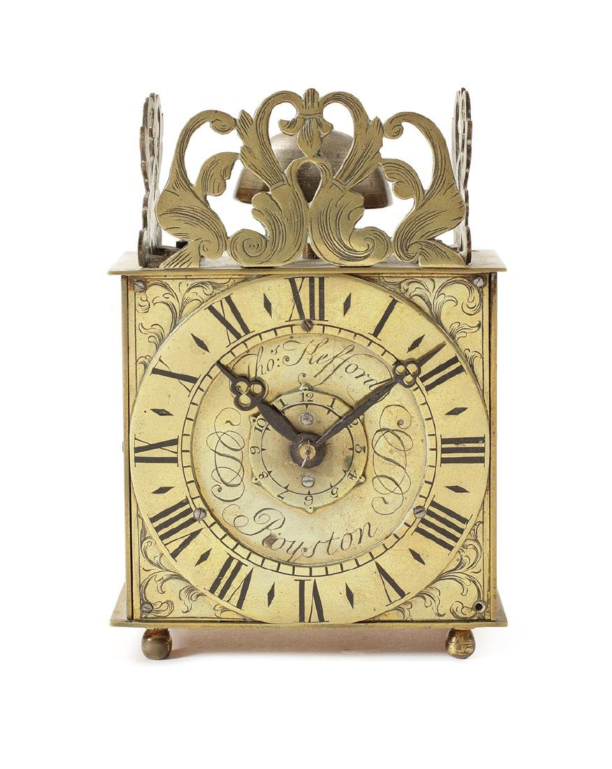 A brass time-piece created from an 18thc wall clock
