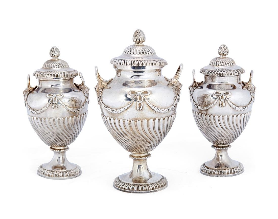 A set of three George III silver tea caddies