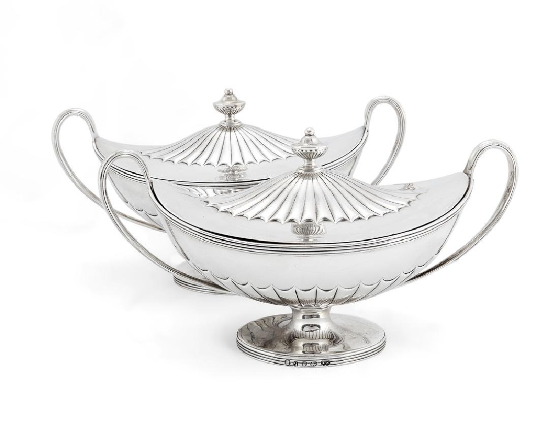 A pair of George III silver covered sauce tureens