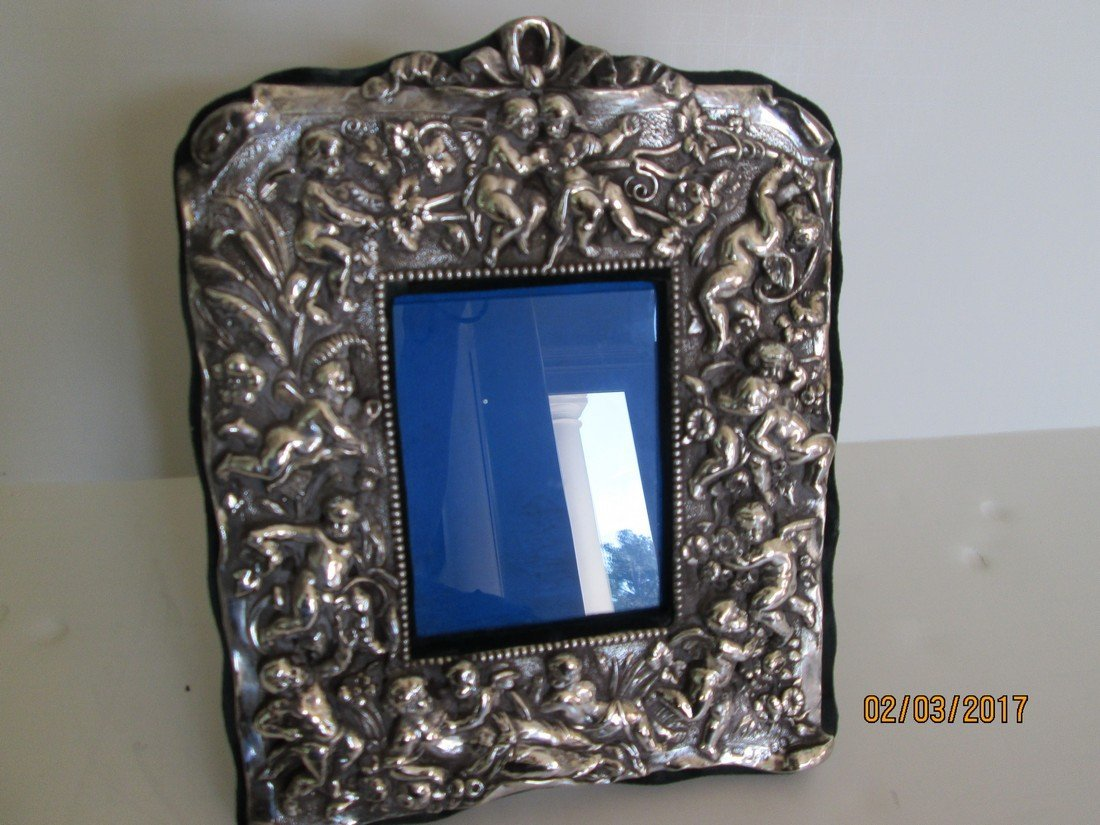 Antique sterling picture frames