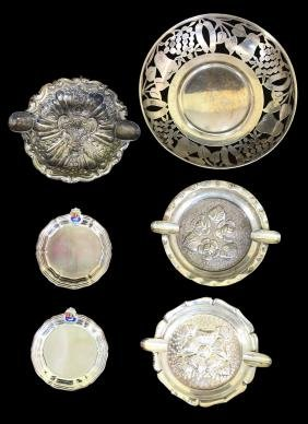 Six Silver Small Plates