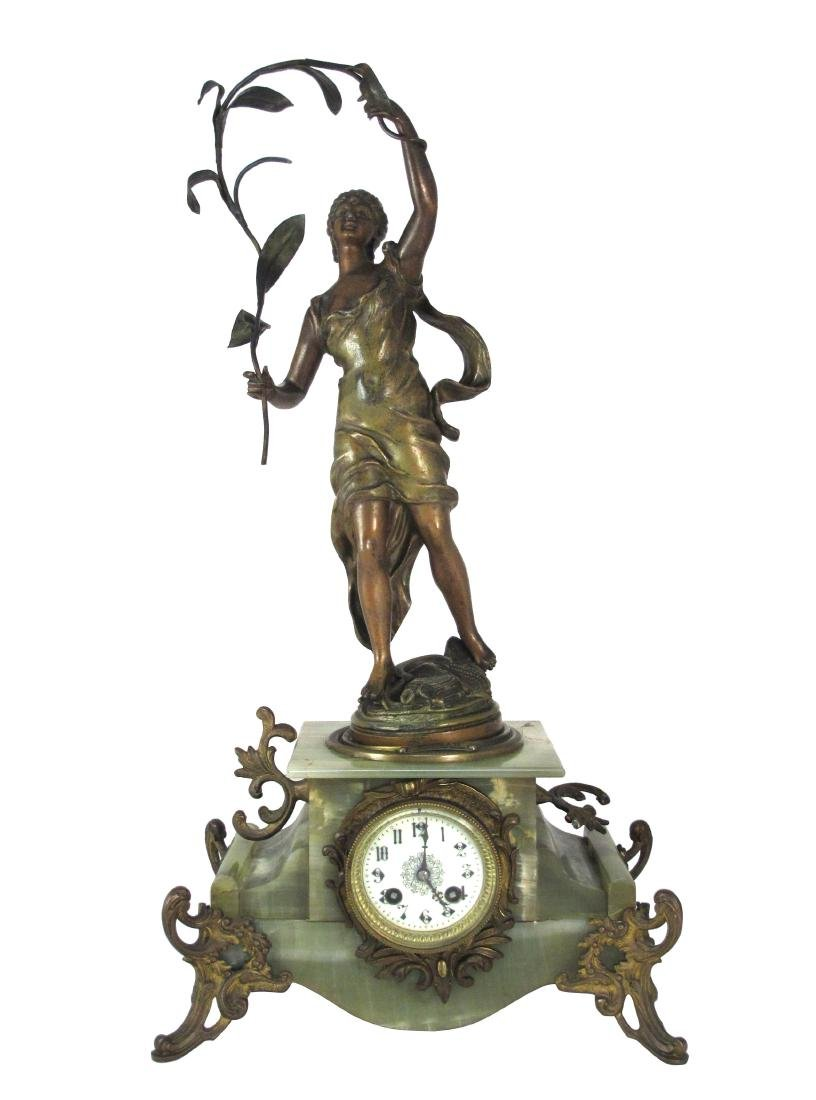 A Bronze Status Stand On Jade Clock