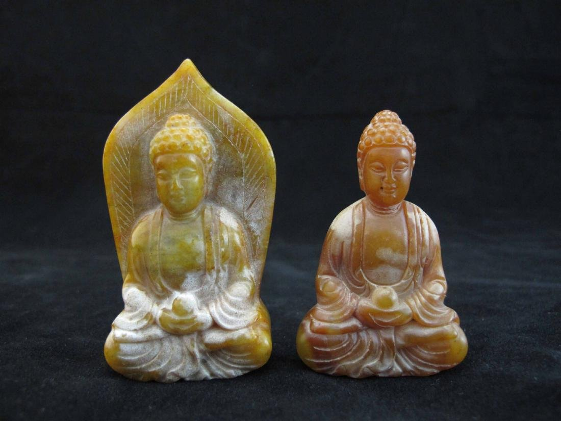 Two Carved Jade Seated Buddhas