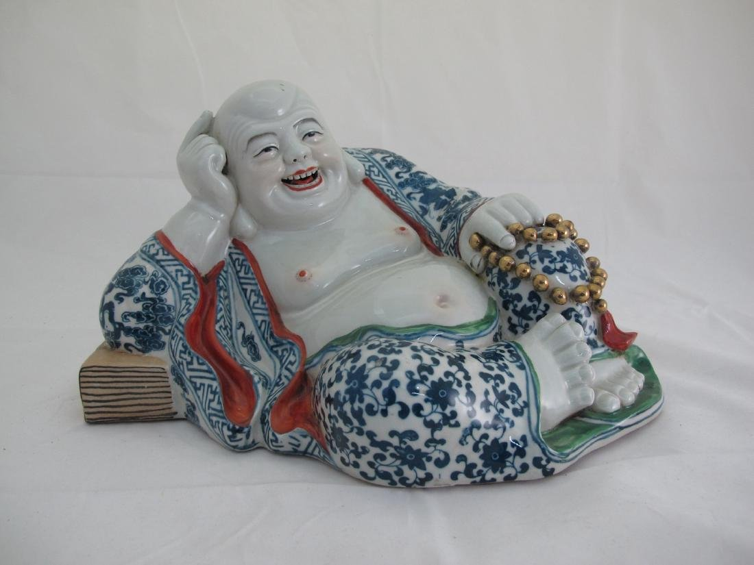 A Chinese Porcelain Buddha Statue