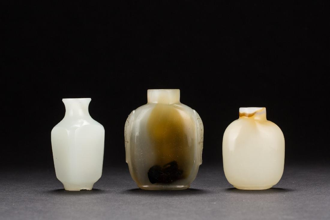 A Chinese group of three agate snuffle bottles Qing