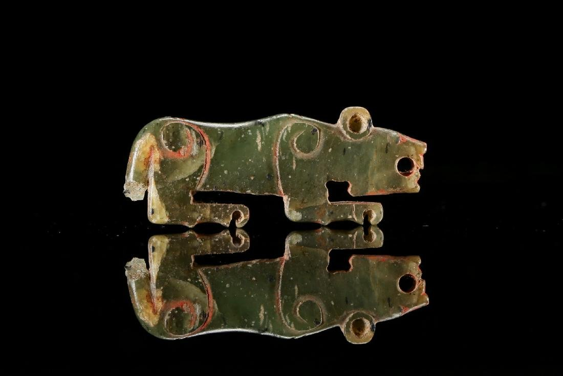 A Chinese carved tiger Green-Jade pendant Han Dynasty