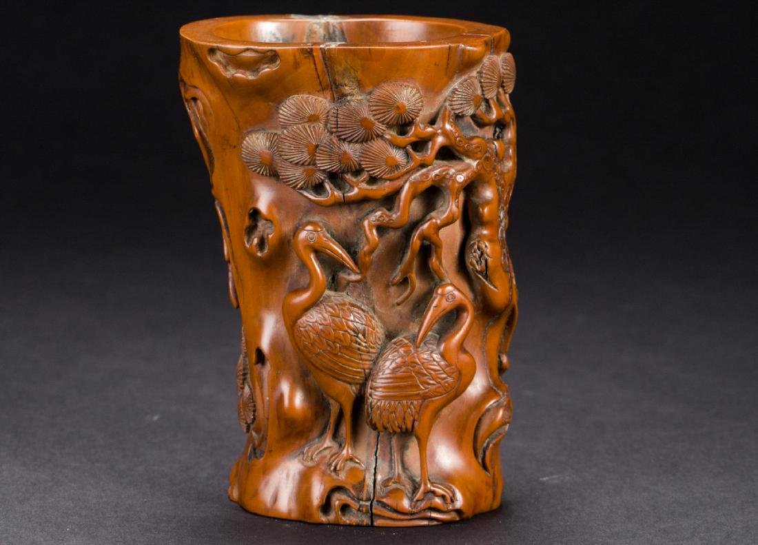 A Chinese carved pine and crane brush pot from Qing