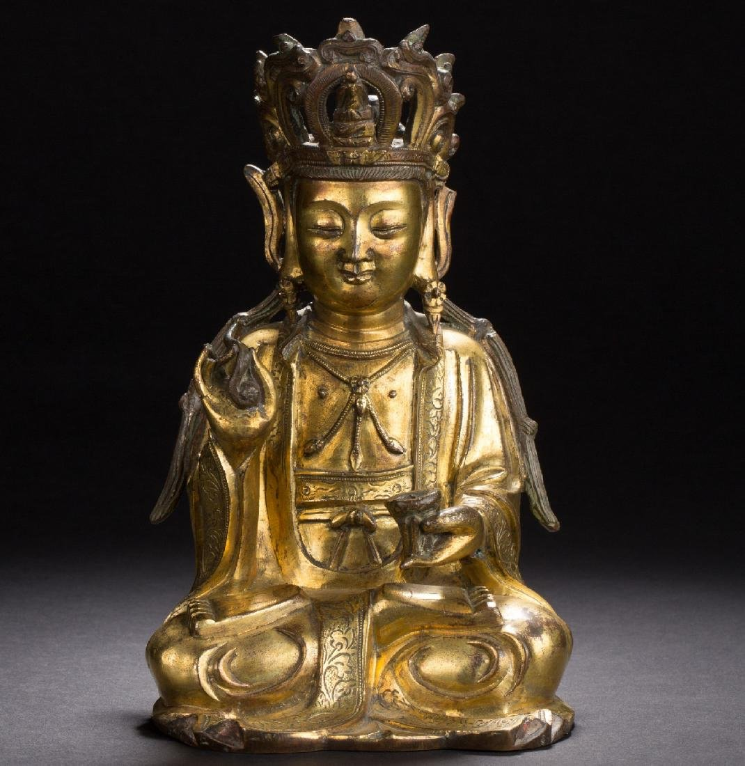 A Chinese gilt bronze figure of Maitreya from Ming