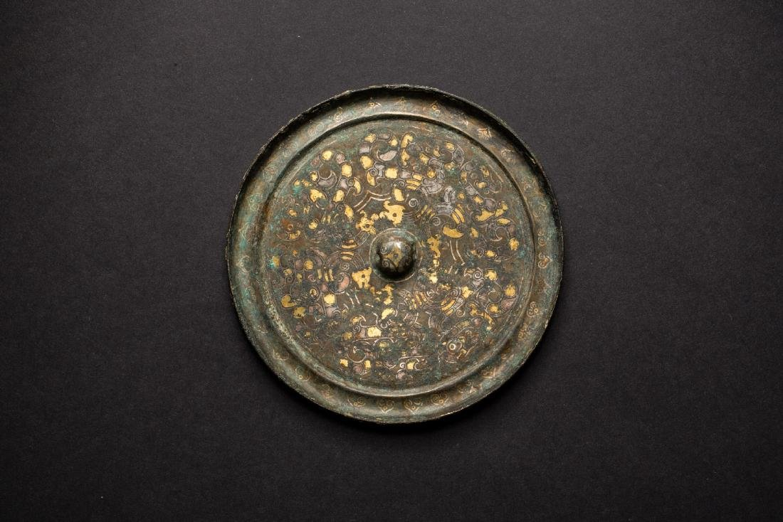 A gilt gold &Silver on Pewter Mirror Warring States