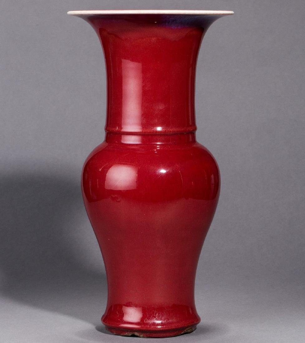 A copper-red glazed trumpet-neck baluster vase Qing