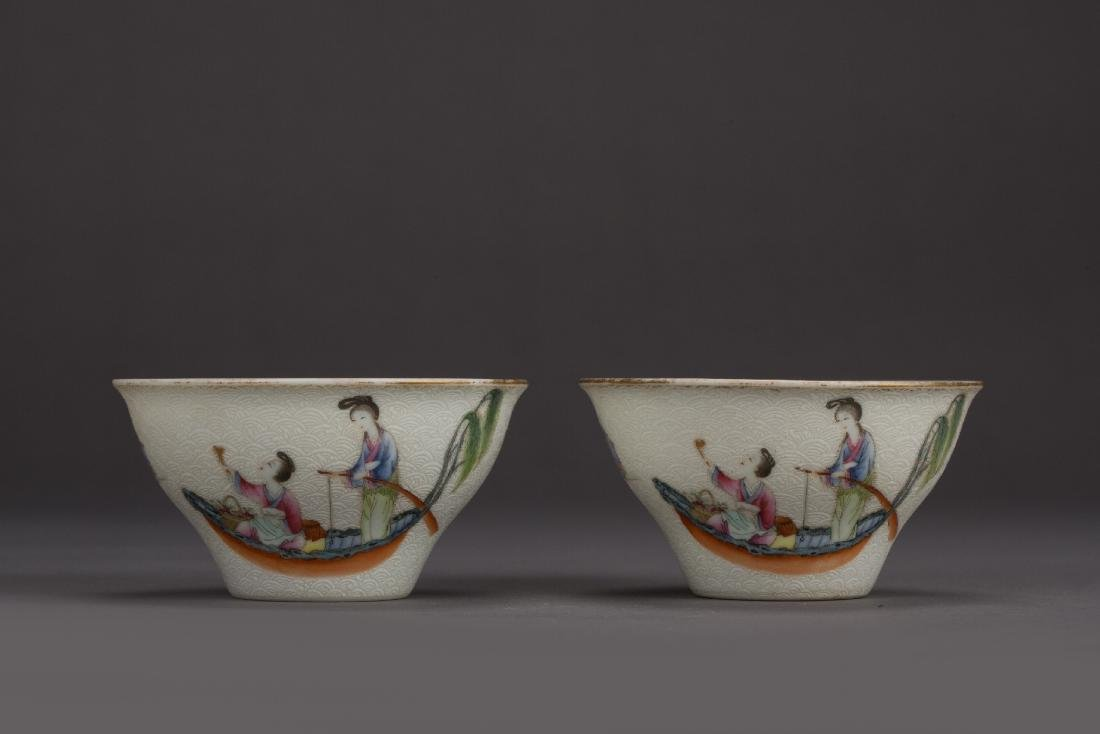 A pair of pastel famille-rose figural cups DaoGuang