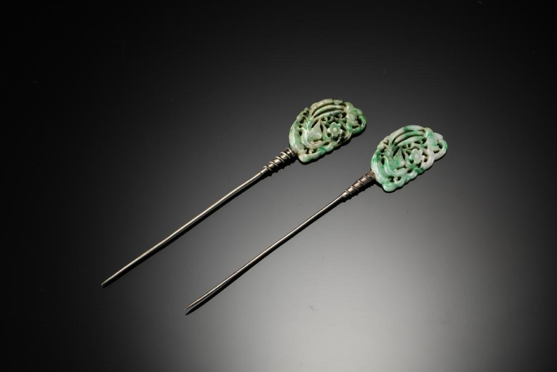 A pair of carved phoenix jadeite with silver hair pins